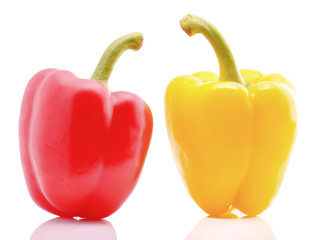 Red and yellow sweet peppers on white background