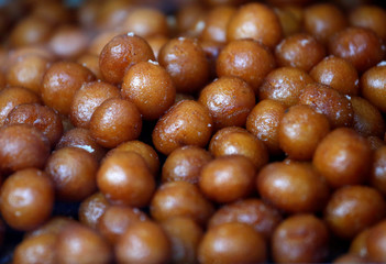 Gulab jamuns (traditional Indian sweet) are on display for sale at a sweets shop in Mumbai