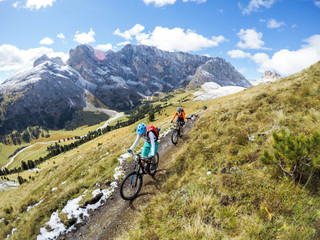 Two women mountain biking in Dolomites, Val Gardena, South Tyrol, Italy