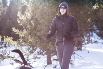 Woman walking her dog in snow, Colorado, America, USA