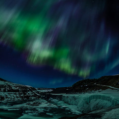 Northern lights over mountains, Iceland