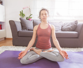 Woman Practicing Yoga and Meditation