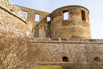 Historic castle ruin at Borgholm, Oland in Sweden. A popular travel destination with historic values. One of the circular corner towers and part of the perimeter defensive wall.