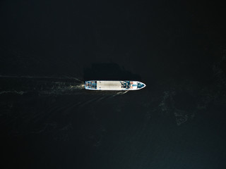 aerial view of excursion boat with passengers on river