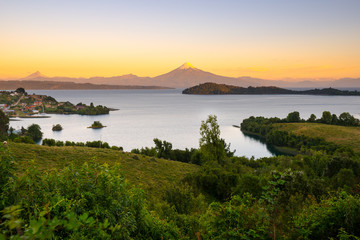 View of Puerto Octay at the shores of Lake Llanquihue, with Osorno Volcano and Puntiagudo Volcano in the back, X Region de Los Lagos, Chile