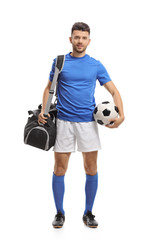 Soccer player with a sports bag and a football
