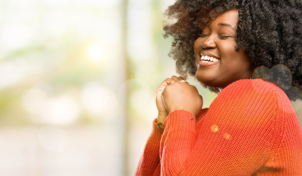 Beautiful african woman confident and happy with a big natural smile laughing, outdoor