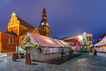 Decorated and illuminated Christmas tree, Christmas Market and the Cathedral of Saint Mary at Cathedral Square, Doma laukums, Riga, Latvia.