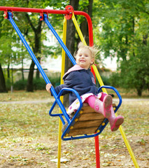 child riding on a swing