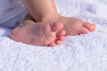 baby feet on white blanket