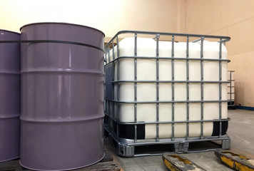 The large white and purple tanks chemical packaging inside of the factory.