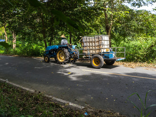 Local man drives farm tractor truck on road