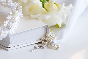 First holy communion accessories on white background