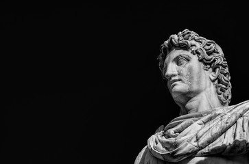 Ancient statue of mythical character Castor or Pollux, dated back to the 1st century BC, located at the top of monumental balustrade in Capitoline Hill, in Rome (Black and White with copy space)