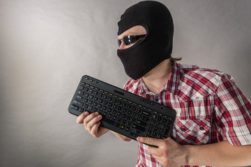 Man wearing balaclava shooting from keyboard