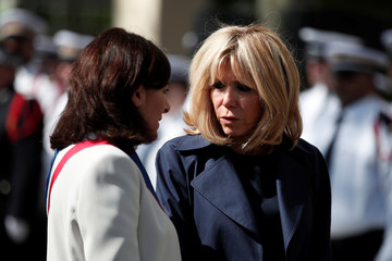 Brigitte Macron, wife of French President Emmanuel Macron, and Paris city mayor Anne Hidalgo attend a ceremony to pay tribute to Xavier Jugele in P