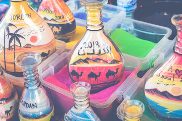 Souvenirs from Jordan - bottles with sand and shapes of desert and camels.