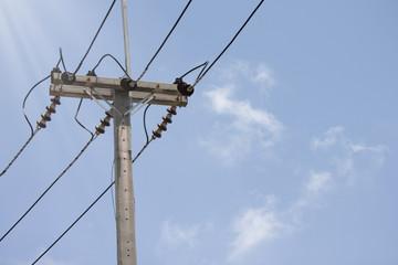 Electricity pole with background blue sky.