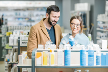 Couple choosing cosmetics in the pharmacy