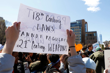 Youths take part in a National School Walkout anti-gun march in Washington Square Park in the Manhattan borough of New York City