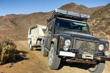 4x4 vehicle and caravan in rough terrain