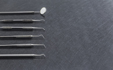 dental tools on gray background top view