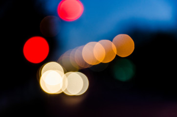Lights of the night city. Street traffic. Defocused photo.