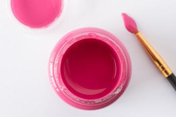 A bottle of pink artist paint