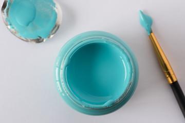 A bottle of blue artist paint