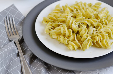 Cooked fusilli pasta on a plate with pesto, Italy food, healthy concept, vegetarian