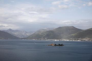 A church is seen on a small island near Tivat