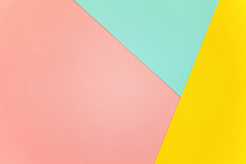 Blue, yellow and pink pastel color paper geometric flat lay background