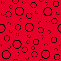Seamless background consisting of black circles of different sizes on a red background. Vector illustration.