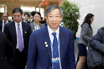 China's Central Bank Governor Yi Gang arrives at IMFC plenary