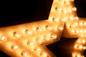 Decorative star with lamps on a background of wall. Modern grung