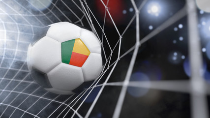 Realistic soccer ball in the net with the flag of Benin.(series)