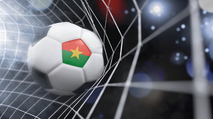 Realistic soccer ball in the net with the flag of Burkina Faso.(series)