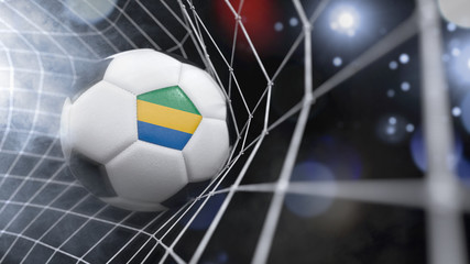 Realistic soccer ball in the net with the flag of Gabon.(series)