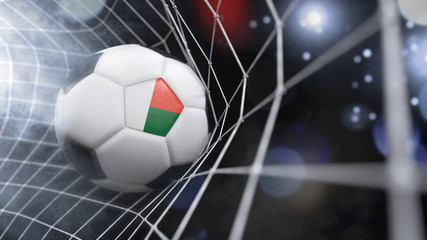 Realistic soccer ball in the net with the flag of Madagascar.(series)
