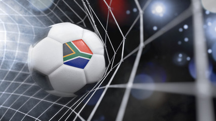 Realistic soccer ball in the net with the flag of South Africa.(series)