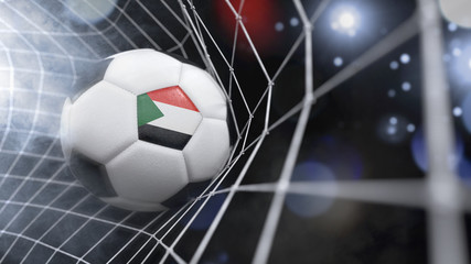 Realistic soccer ball in the net with the flag of Sudan.(series)