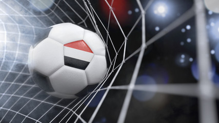 Realistic soccer ball in the net with the flag of Yemen.(series)