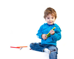 A little child of three years is played with pencils. Isolated on a white background