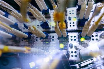 Close up fiber optic cable. Servers racks.