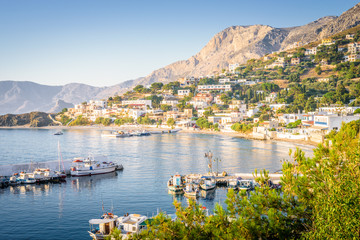 Kalymnos Island, Massouri, Kos, Dodecanese, Greece: Beautiful sunny village town harbor view to the greek blue sea with crystal clear water with fishing boats cruising holiday yacht laying on shore