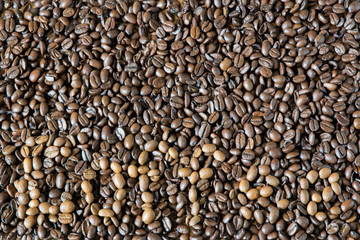 Coffee beans of two types, with title Coffee is made from light grains