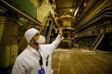An employee is seen in a pump room of the stopped third reactor at the Chernobyl nuclear power plant in Chernobyl