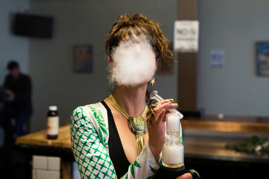 Elise McRoberts exhales after using a full spectrum oil vaporizer at the new Magnolia cannabis vape lounge in Oakland