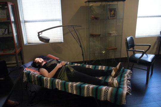 Hannah Landau uses light therapy for relaxation at the new Magnolia cannabis lounge in Oakland