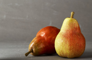 Red Pear on grey background